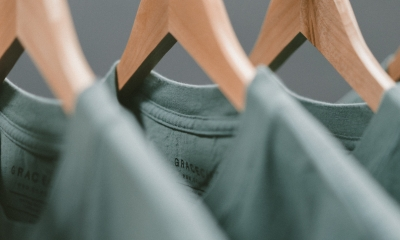 Green T-shirts on clothes hangers