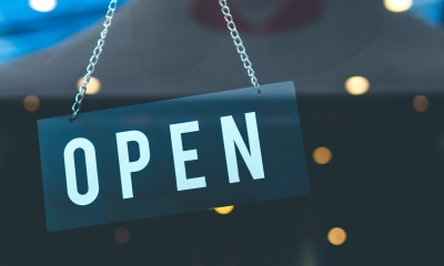 Open for business sign in store window